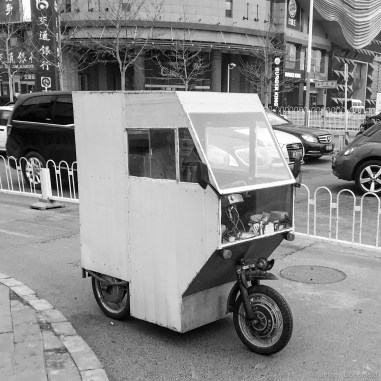 """I love these rickshaw mopeds. They come in lots of varieties, ranging from crappy home-made ones like this, to pre-manufactured slick metal ones that resemble am airstream trailer. A friend of mine and I play an iOS game called """"Pako"""", and this one looks exactly like the one that can be driven in that game. Cool!"""