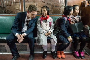 Riding the Pyongyang metro was a great opportunity to interact with some of the locals. Here, I'm sitting next to a group of school girls, who are getting nervous while practicing their english skills.
