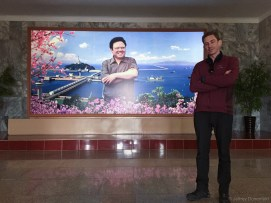 Inside the Nampho Dam (P'i Do) Lighthouse is another great portrait of Kim Jong Il, posing in front of the dam.