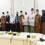 Pemkot Tanjungbalai Bersama PT Bank Sumut Serahkan 115 Buku Tabungan Simpanan Pelajar