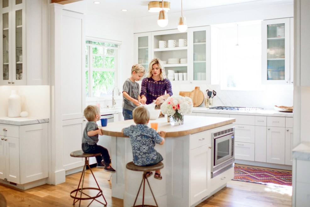 mom with kids in kitchen