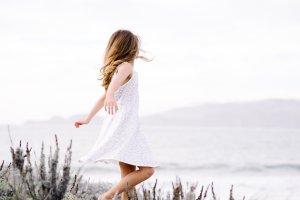 Girl on breezy beach