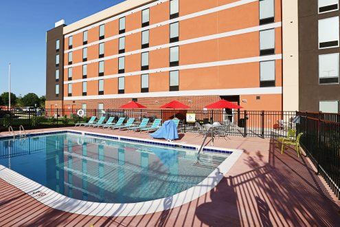 Swimming pool and building exterior at the Hilton Home 2 Suites hotel in Knoxville, Tennessee