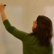 Teacher doing match on white board.