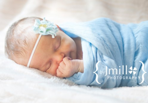 Newborn poses with cheesecloth