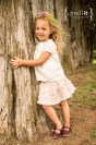 Girl posing next to tree