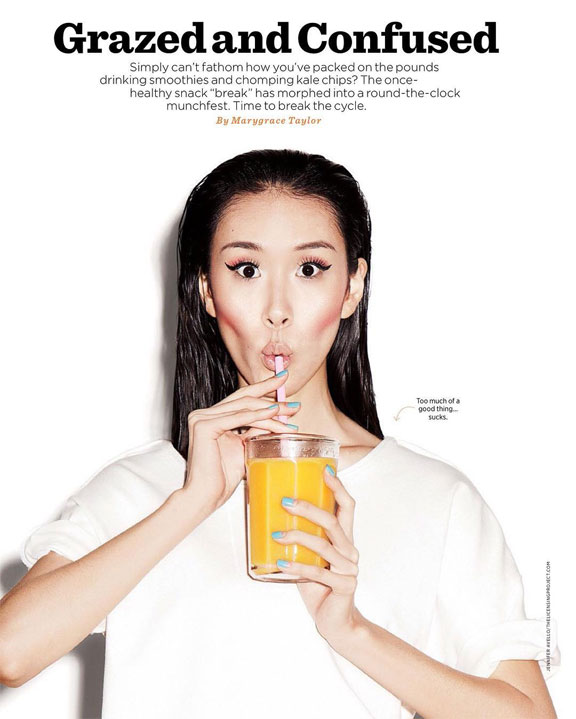 Portrait of girl drinking juice from a straw