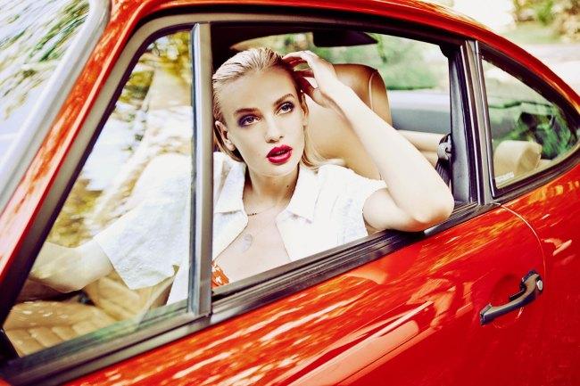 Girl driving red porsche