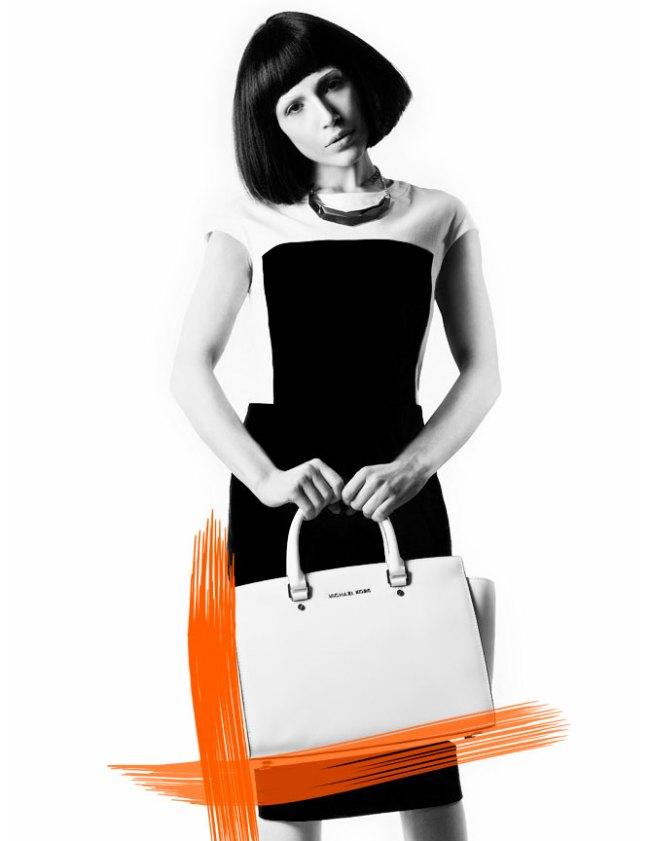 Model with Bob holding a Michael Kors bag