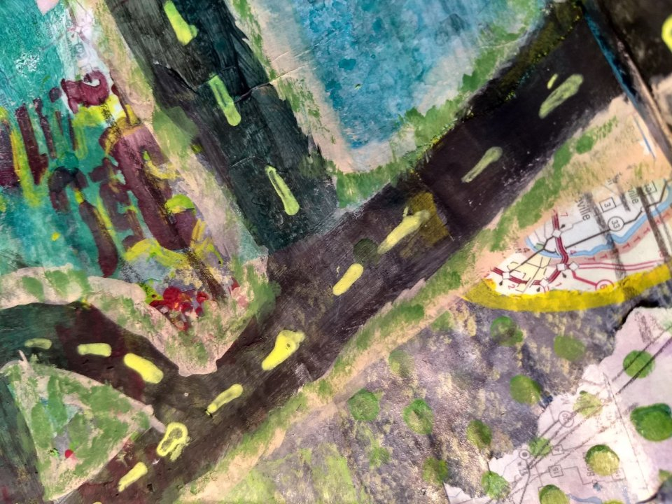 painted intersecting roads in art journal.
