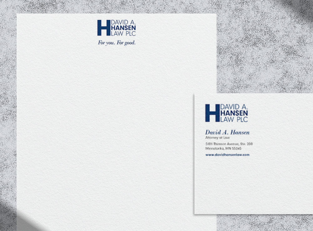 Photo of David's letterhead and envelope over a textured background.