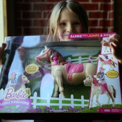 Mattie holding her Barbie