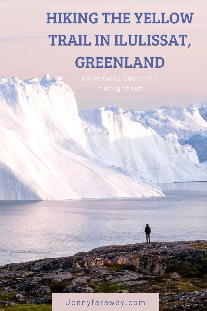 A man stands on the coast looking at the Ilulissat Icefjord.