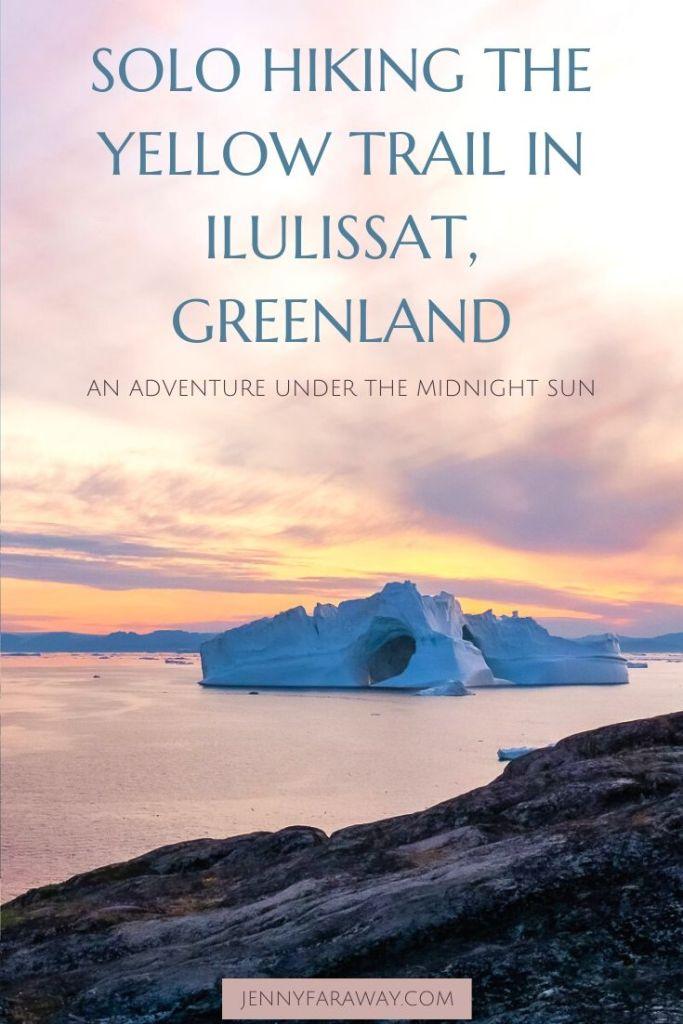 The midnight sun shines over an enormous iceberg in Ilulissat, Greenland.
