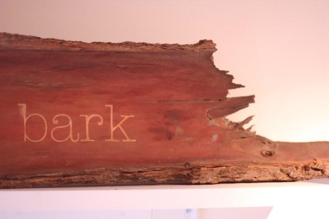 Bark bark (2013): bark and sandblasted lettering. NFS
