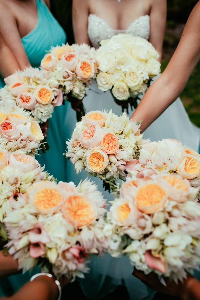 Bouquets of hydrangea, garden roses, blushing bride, and calla lilies