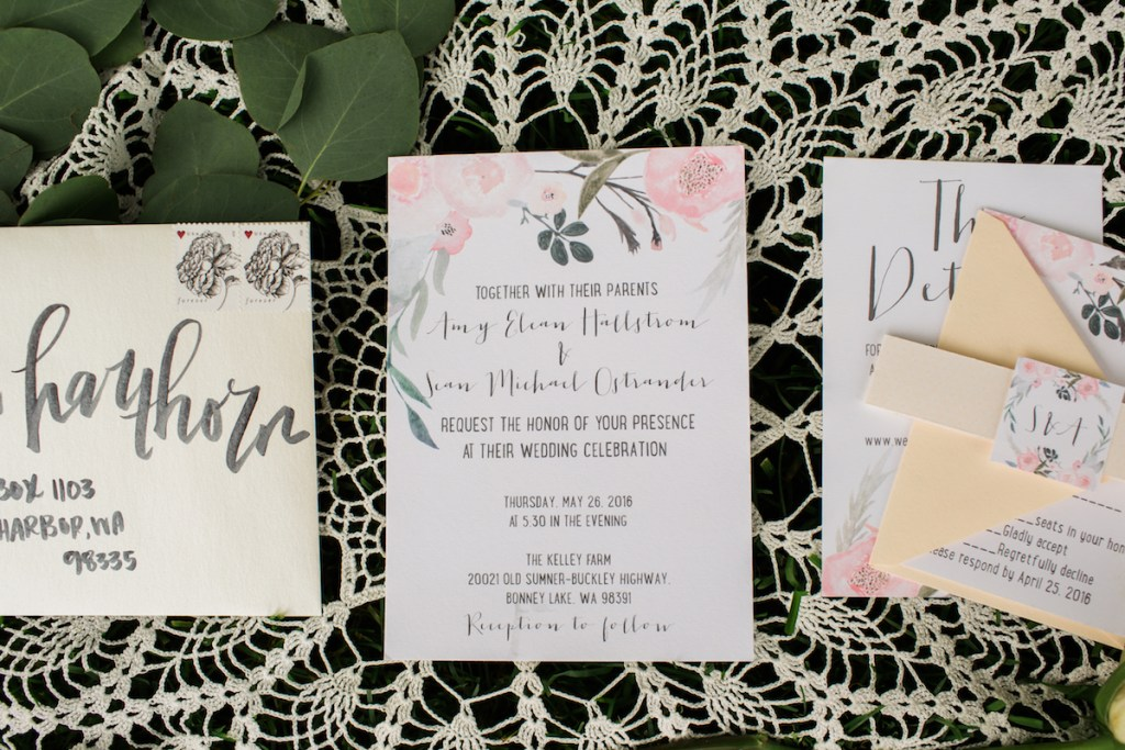 Floral Invitations with brushed calligraphy envelopes.