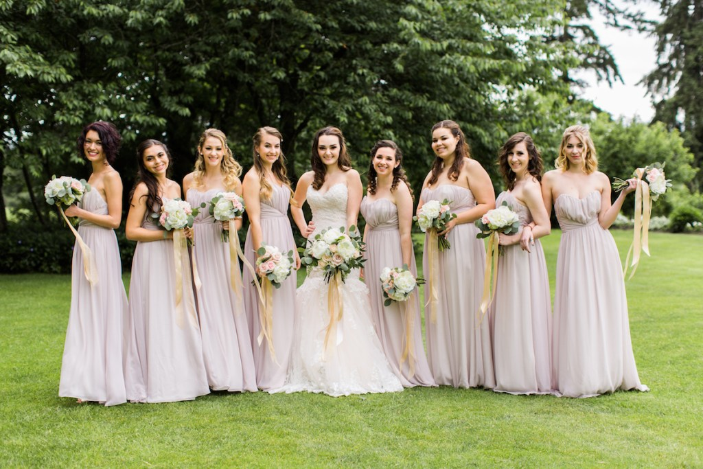 Bride with bridesmaids at Kelley Farm. Bouquets by Jen's Blossoms