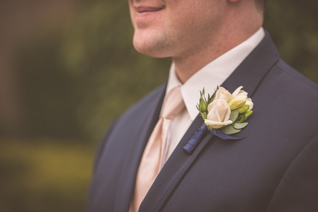 Spray rose boutonniere by Jen's Blossoms.  Tacoma Wedding