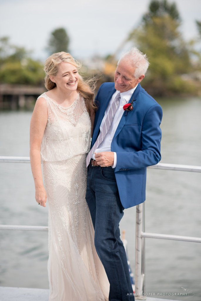 Bride and Groom on boat in Puget Sound; Foss Waterway Seaport