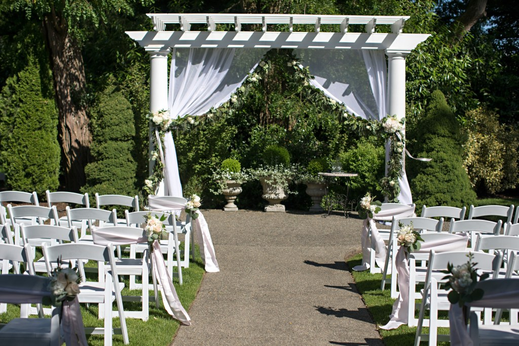 Draped arbor with garland at Laurel Creek Manor; Flowers by Jen's Blossoms