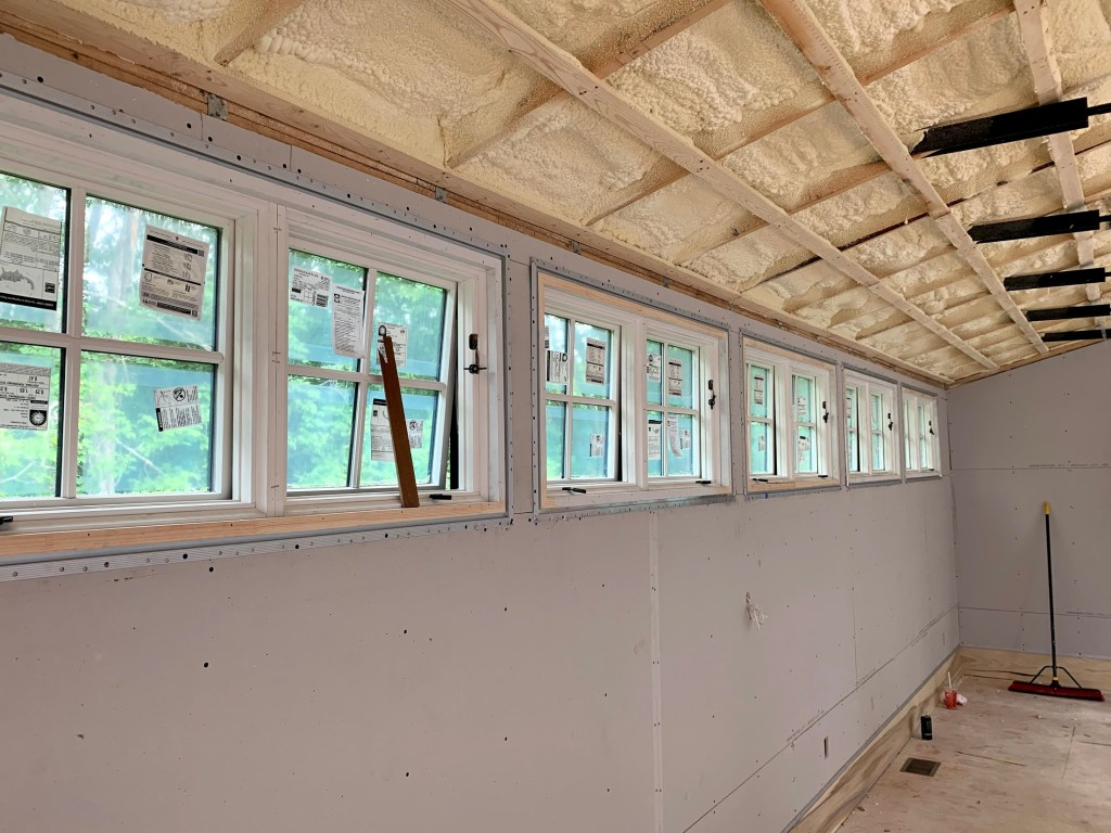 Windows, mouldings, and ceilings of renovated barn in Sherborn MA