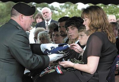 The widow and sons of fallen Army Captain Chris Cash, 36 (2004).