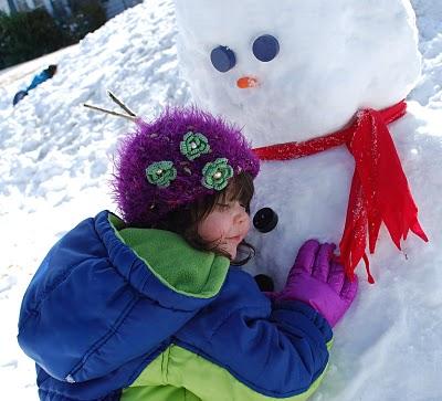 Little GIrl Hugs Snowman