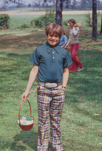 Easter 1975 adolescent boy hunting Easter eggs in plaid pants