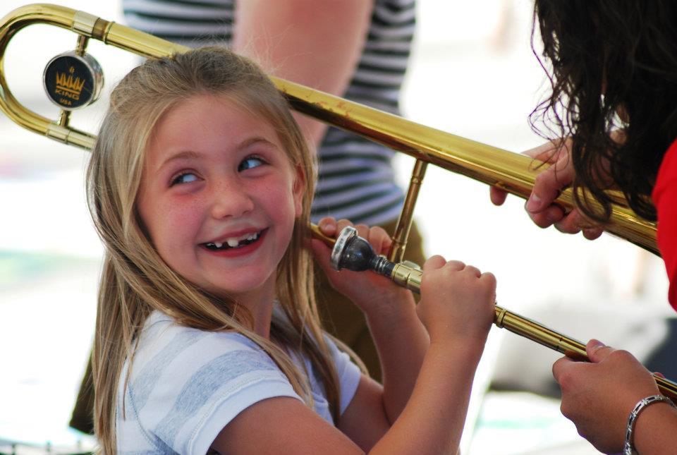 Girl Playing a Trombone