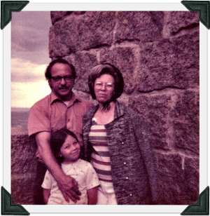 Child with parents during the 70s