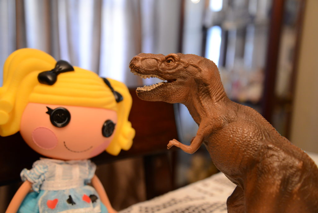 T. Rex tries to eat Alice in Lalaloopsy Land's head.