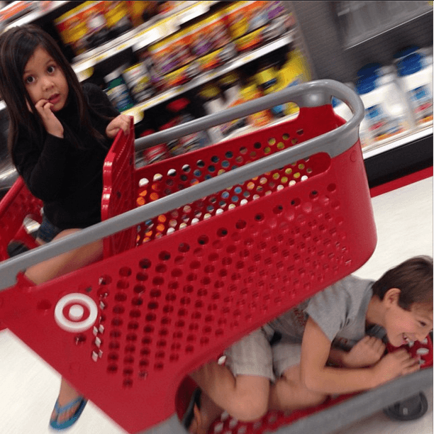 Kids in a shopping cart at Target