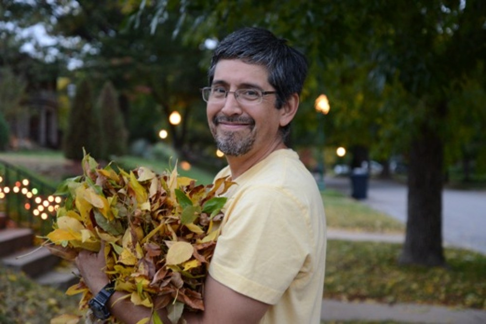 Man with arm full of leaves