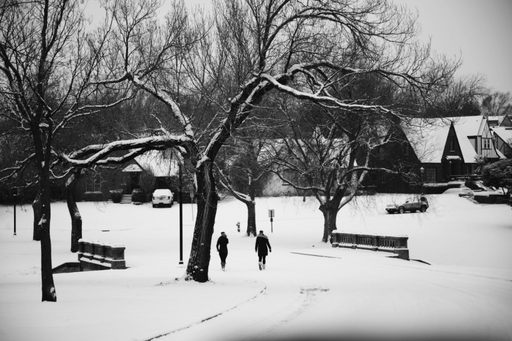 People Walking in the snow across bridge