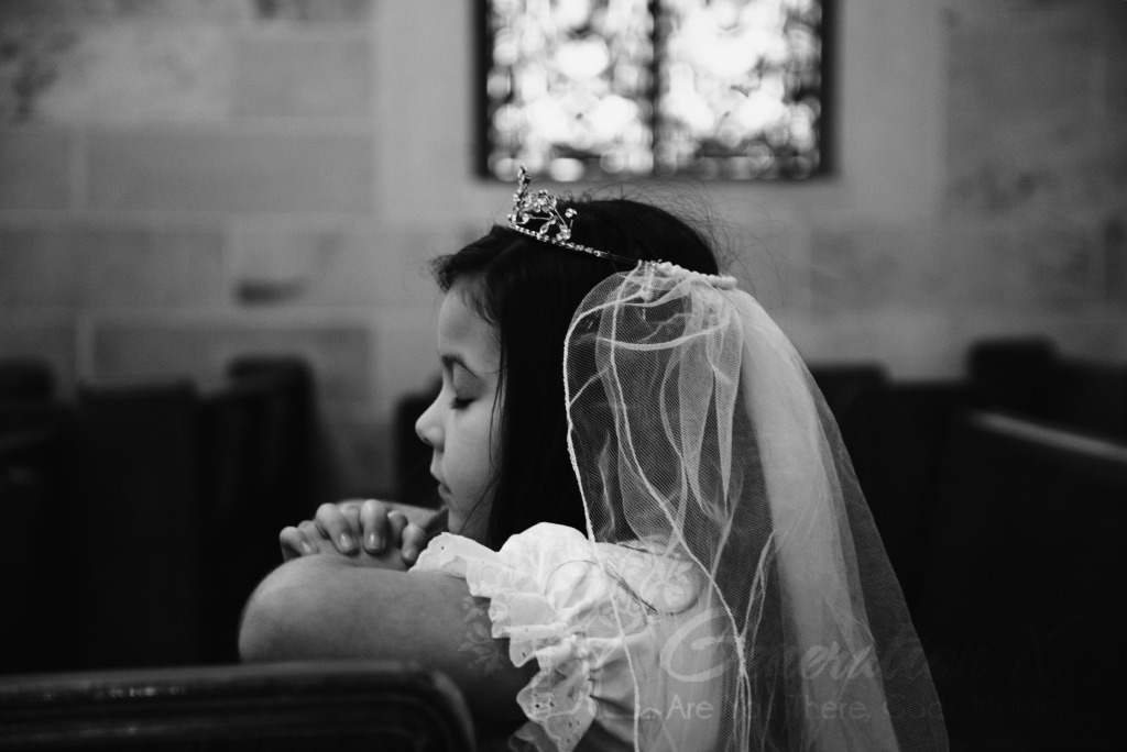 Girl Praying before First Communion