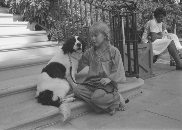 Amy Carter in braids with her dog
