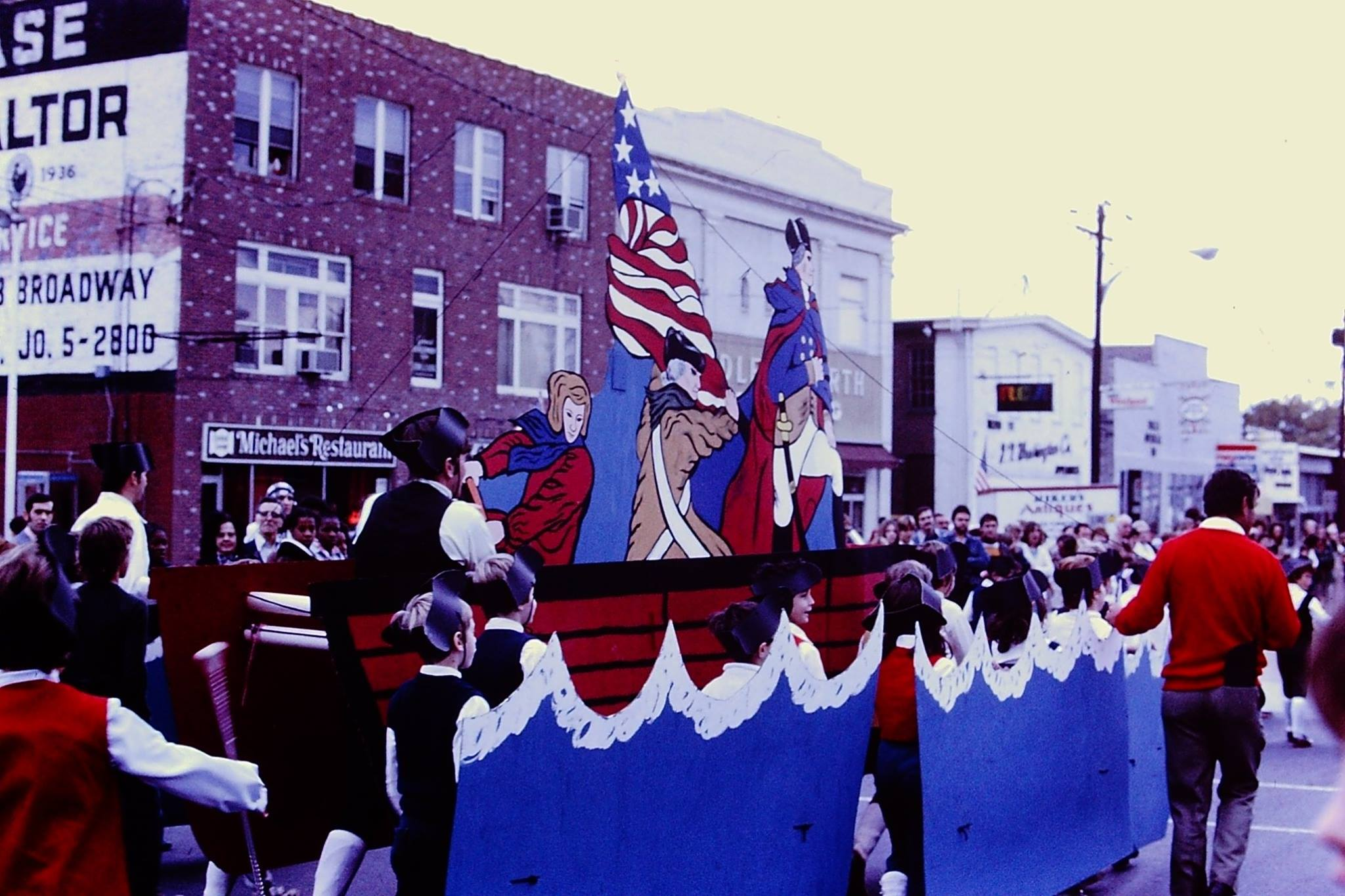 A town celebrates Washington Crossing the Potomac in a parade down the main street of Newburgh, New York, 1975