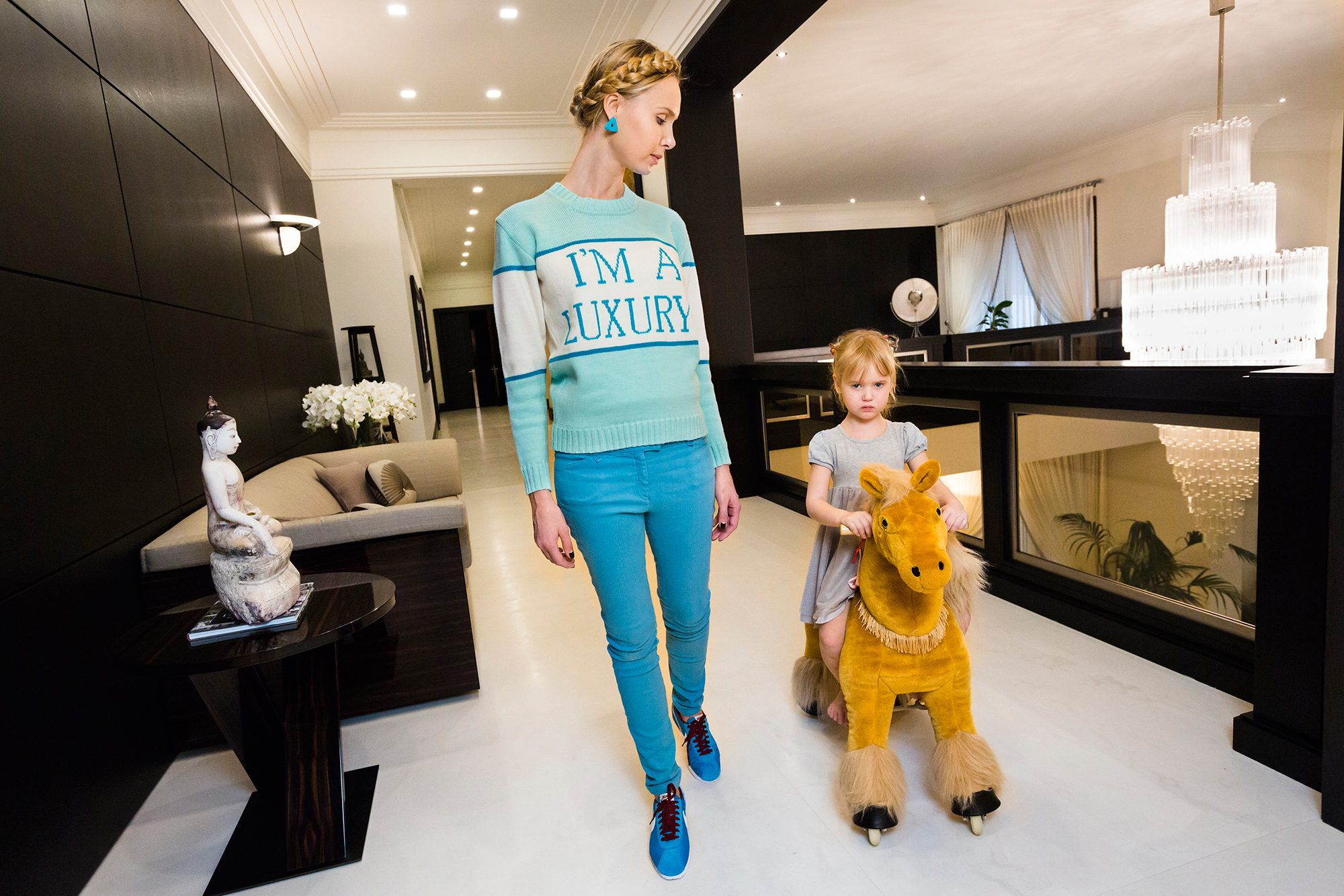 """I am a luxury"" sweater from GENERATION WEALTH by Lauren Greenfield"