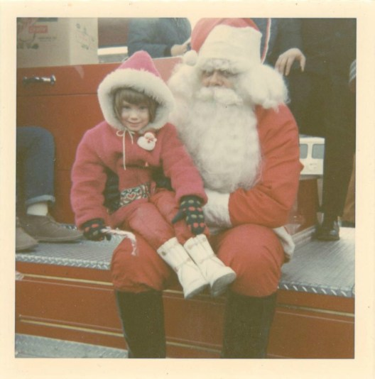 A Gen-Xer sits on Santa's lap in this early 1970s Snapshot.