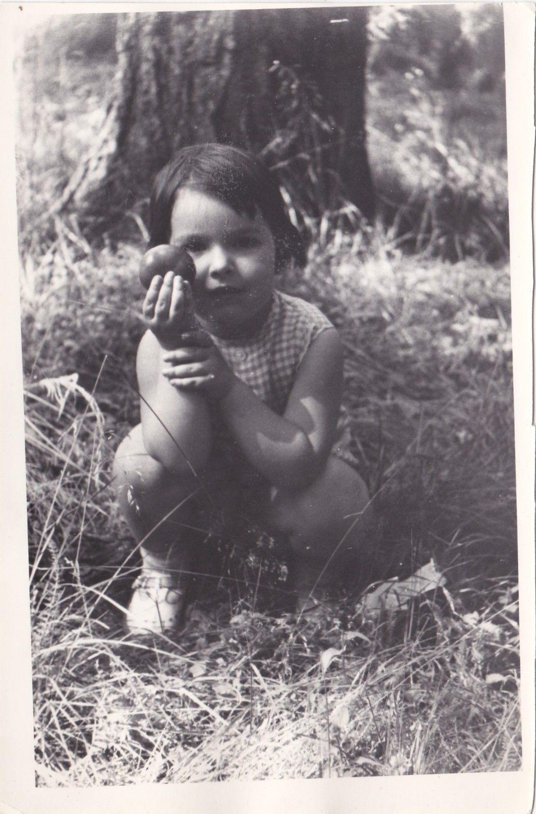 russian girl 1975 holds piece of fruit