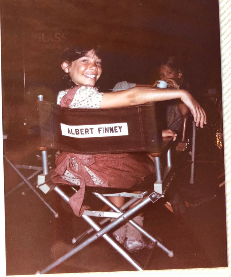 Meredith Salenger in Albert Finney's chair on the set of the 1982 movie Annie. Salenger also starred in the 1989 teen film Dream A Little Dream. Corey Feldman and Corey Haim also starred in the picture.