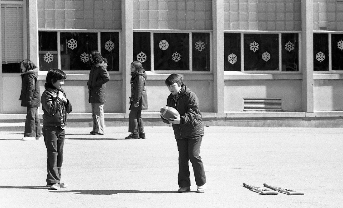 Boys Playing Football at Recess Winter 1974
