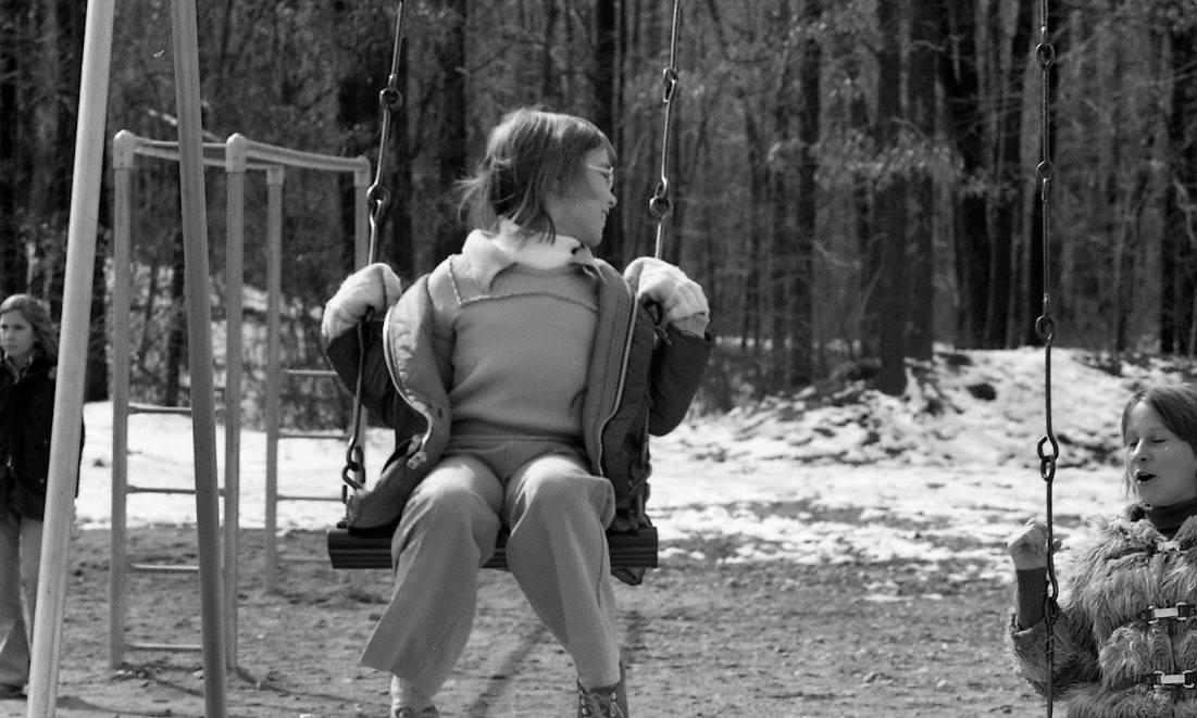 Girl Swinging at Recess Winter 1974