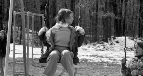 Gen X Girl Swinging at Recess Winter 1974