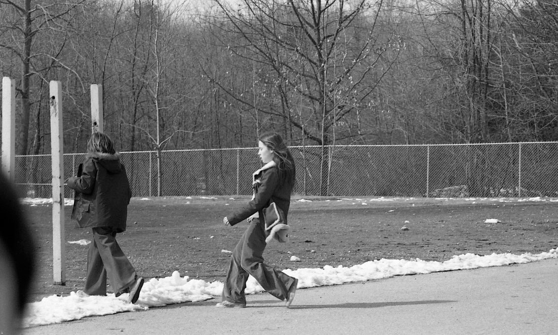 Girl in a fake sherpa on the playground winter 1974
