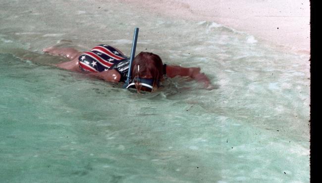 Girl Snorkeling near the shoreline of a beach 1976