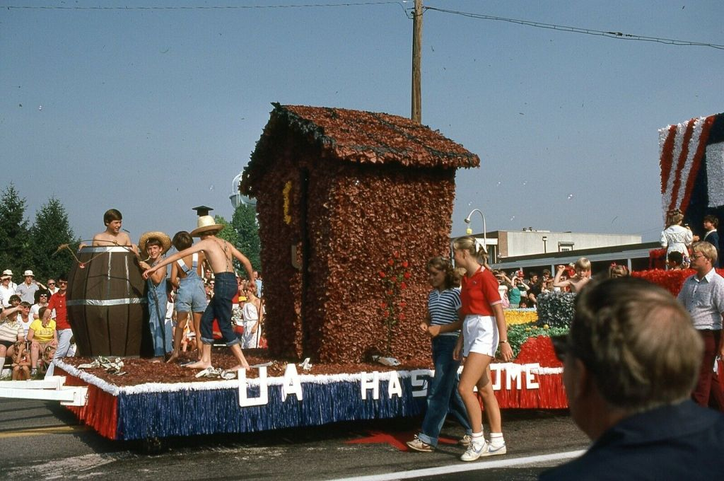 I have no idea what's going on with this parade float. Is that an out house?