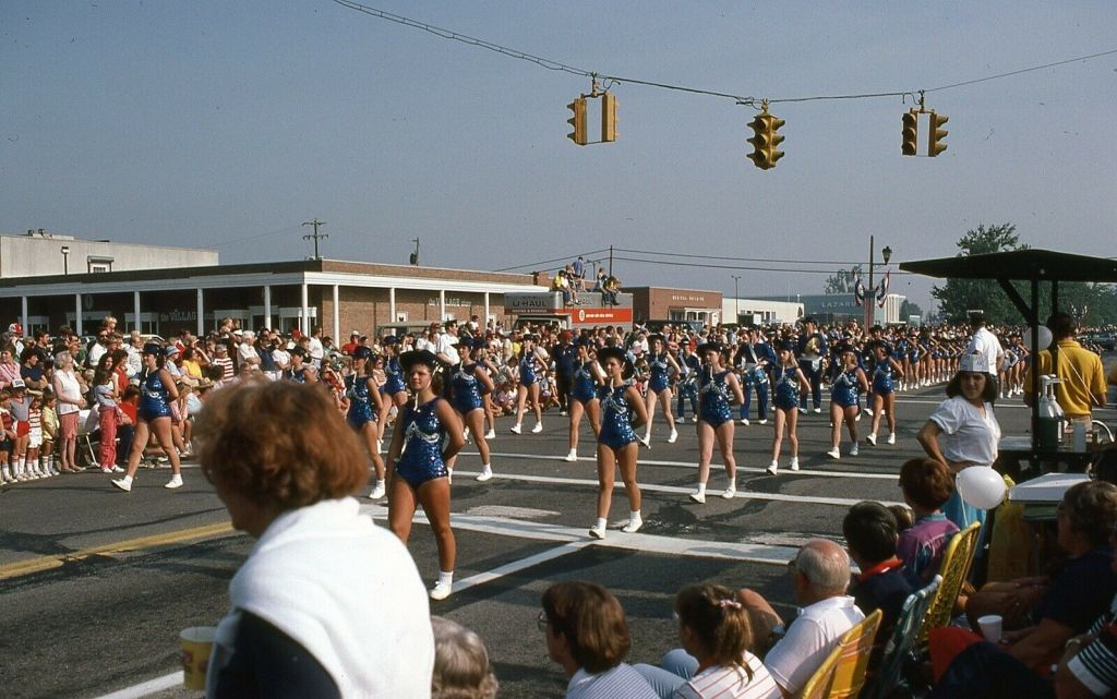 Majorettes and Baton Twirlers March in a Fourth of July Parade, 1982