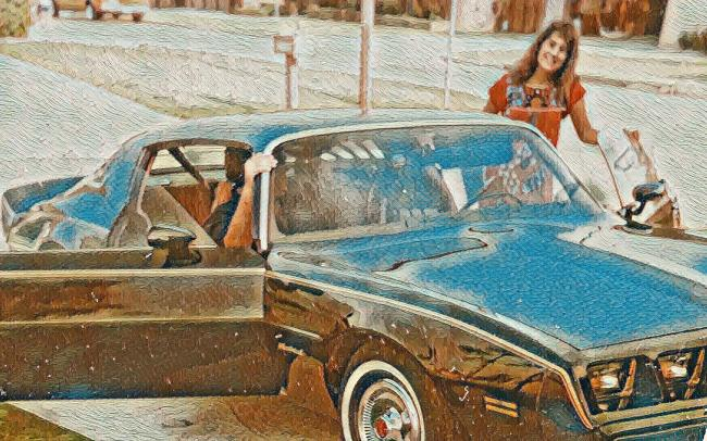 Jeanna and her first black sports car, early 1980s